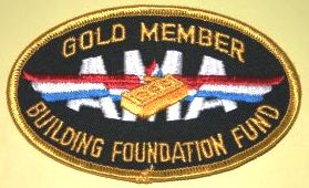 To encourage monetary donations towards the building costs. several levels of donation to the building fund were set up and donor received various items at each level.  This patch indicated that the donor had given at the Gold level, or the highest level towards the building fund.  (Source: National Model Aviation Museum Collection, AMA Collection, 2005.02.101.)