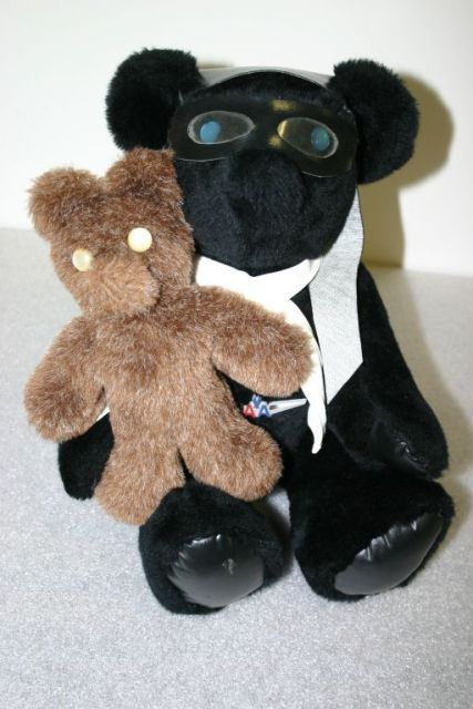 Two bears made by Dolly.  The smaller one is the type that she would take as a kit to international events.  (Source: National Model Aviation Museum Collection, donated by Jay Mealy, 2010.44.01-.02.)